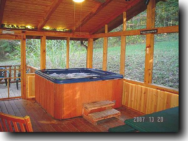 Private and romantic hot tub surrounded by woods